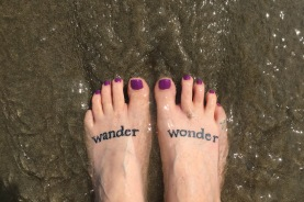 My feet take a dip in the Pacific.